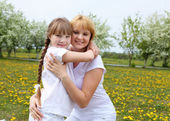 Girl with mother in spring park — Стоковое фото
