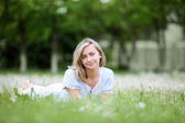 Young blond woman in the park — Stock Photo
