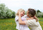 Girl with mother in the park — Foto Stock