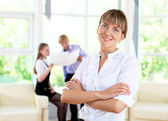 Businesswoman in office — Stock Photo