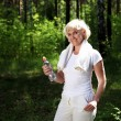 Royalty-Free Stock Photo: Elderly woman after exercising in the forest