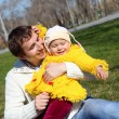 Little girl with father in spring park - Foto Stock