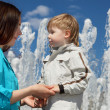 Young boy and his mother walks in the park — Stock Photo #5905930
