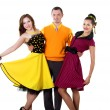 Young man with two women in bright colour wear — Stock Photo #5912552