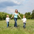 Royalty-Free Stock Photo: Mother with her two sons outdoors