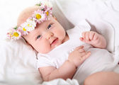 Portrait of a baby with a wreath — Stock Photo