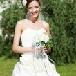 Portrait of a young bride in a white dress — Stock Photo #5959532