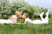 Girl with mother in spring park — Stock Photo