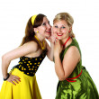 Stock Photo: Two young womin bright colour dresses