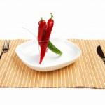 Bright red and bright green chilli pepper — Stock Photo #5985464