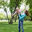 Portrait of mother with daughter outdoor - Stock Photo
