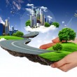 Human hand holding a green city — Stock Photo #6005094
