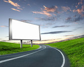 Billboard on the road — Stock Photo