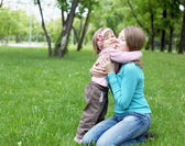 Portrait of mother with daughter outdoor — Stock Photo