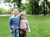 Happy sister and brother outdoors — Foto de Stock