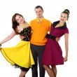 Young man with two women in bright colour wear - Photo