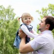 Portrait of father with daughter outdoor — Stock Photo
