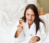 Young woman with glasses of champagne — Stock Photo