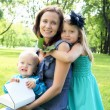 Portrait of mother with two children outdoors — Stock Photo #6057581