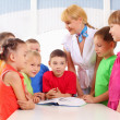 Stock Photo: Teacher deals with students
