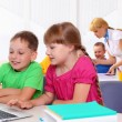 Boy and girl working together — Stock Photo