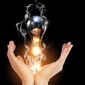 Human hand and bulb — Stock Photo