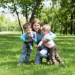 Royalty-Free Stock Photo: Portrait of mother and children in the park