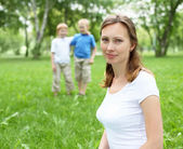 Portrait of mother with two sons on the background — Stock Photo