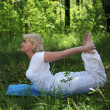 Royalty-Free Stock Photo: An elderly woman practices yoga