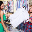 Girl seller helps shoppers — Stock Photo #6124054