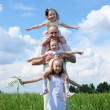 Family with children in summer day outdoors — Stock Photo #6124710