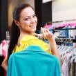 Beautiful young girl at the store — Stock Photo #6129693
