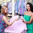 Stock Photo: Shopper at clothing store