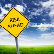 Road sign of risk ahead - Stock Photo