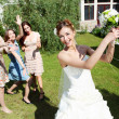 Young bride in white wedding dress - Stok fotoğraf