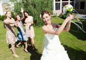 Young bride in white wedding dress — Stock Photo