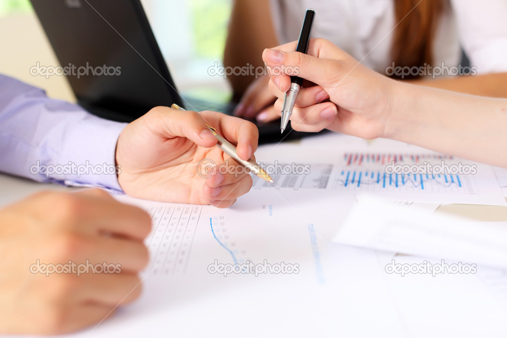 Financial and business documents on the table and human hands — Stock Photo #6159941