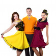 Young man with two women in bright colour wear — Stock Photo #6160134