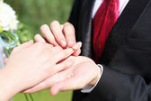 Shot moment when the groom puts the ring — Stock Photo