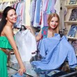 Girl seller helps shoppers — Stock Photo #6183957