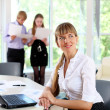 Stock Photo: Business woman in office