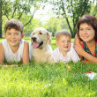 Mother and her two sons in the park with a dog — Stock Photo #6191970