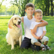 Two brothers in the park with a dog — Stock Photo #6193250