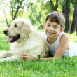 Little boy in the park with a dog — Stock Photo #6193369