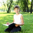 Portrait of a boy with a book in the park — Stock Photo #6193742