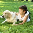 Tennager boy in the park with a dog — Stock Photo #6193980