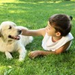 Tennager boy in the park with a dog — Foto de Stock