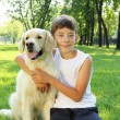 Tennager boy in the park with a dog — Stock Photo #6194075