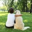 Tennager boy in the park with a dog - Photo