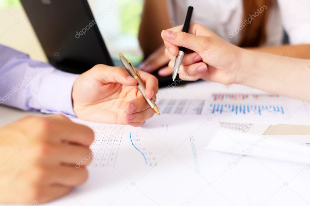 Financial and business documents on the table and human hands — Stock Photo #6192941